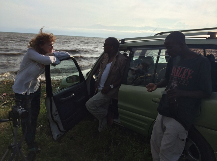 Sundowners: Georgie Weedon  with actors Prospero and Jean Claude, from Theatre et Reconciliation, in Bujumbura, Lake Tanganyika, Burundi