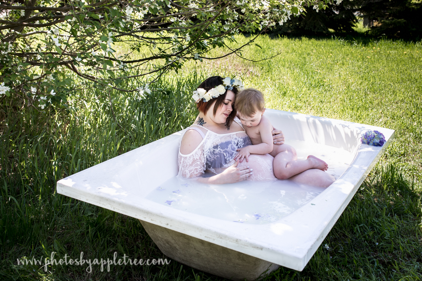 """When her youngest Drax, decided he wanted into the """"pool"""" Dawn brought the soon to be """"big brother"""" in for a cuddle."""