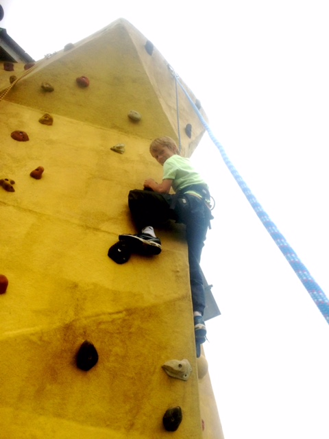 tackling the black and white route on the climbing wall