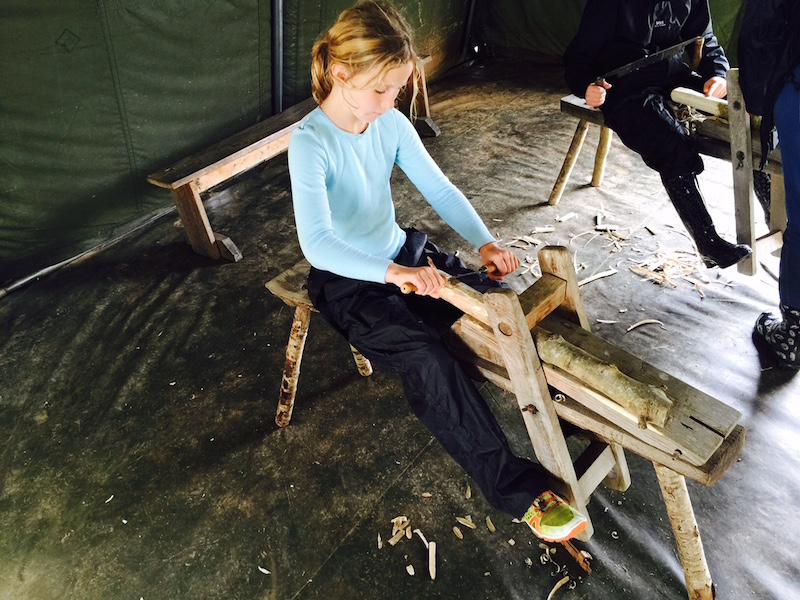 learning how to use a draw knife and shave horse to work a piece of green wood
