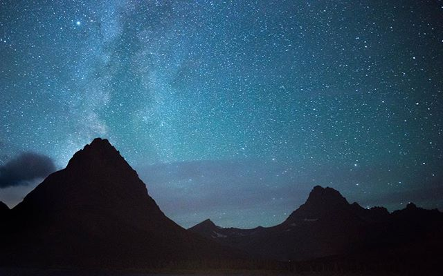 Is this exactly what it looked like in person? No, impossible to see blue like that with the eye in the dark. But when I look at this picture, it does give me the same feeling I had when standing under it in person, which was...wo. Stars rising over many glacier in Montana. #stars #mountains #beautiful #passionpassport #nightsky #travel #glacier #montana @glaciernps #vacation #hike #camping #sky #photography
