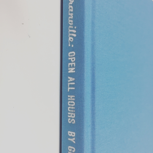 Silver lettering on the spine of one of Book of My Life's biographies