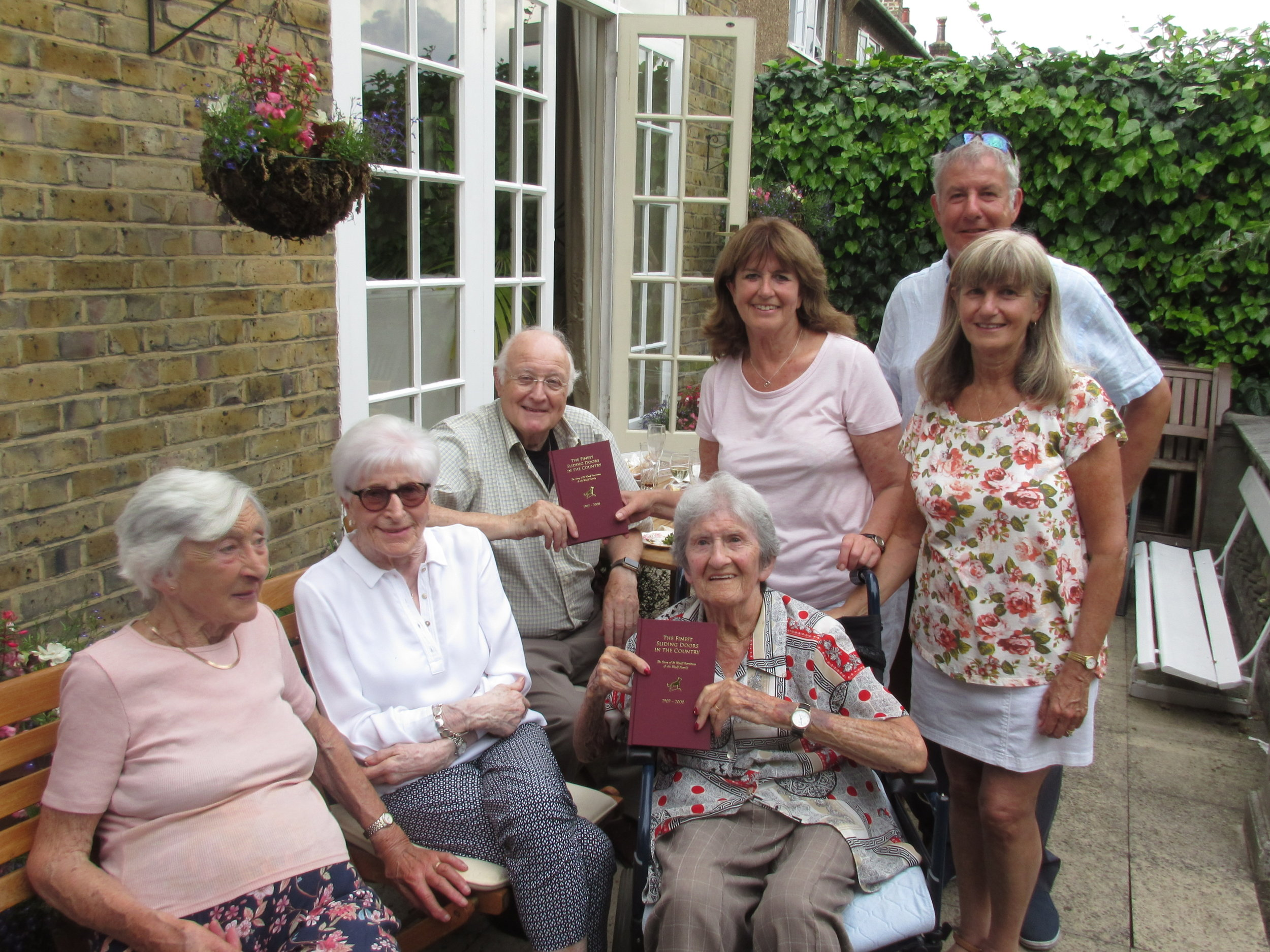 Vivienne with some of her family and copies of her family history book, written and produced by Book of My Life
