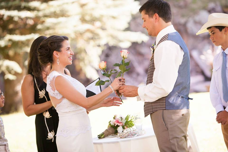 After vows and ring exchange, a rose exchange symbolized enduring love, and Nikki & Scott's first gift to one another as husband & wife.