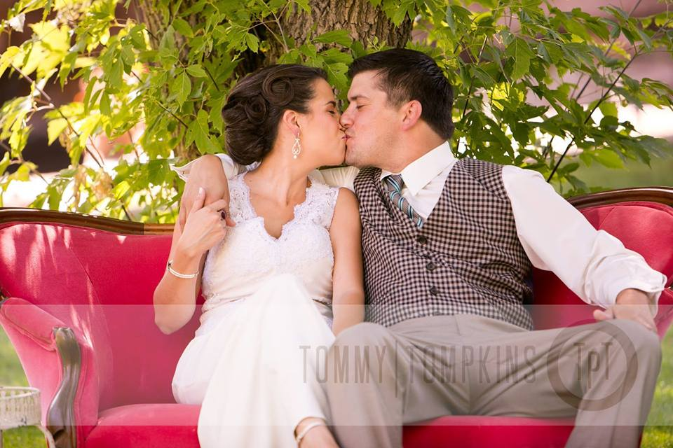 Smooching on the antique furniture that they brought in to decorate the  Riverbend  reception area.