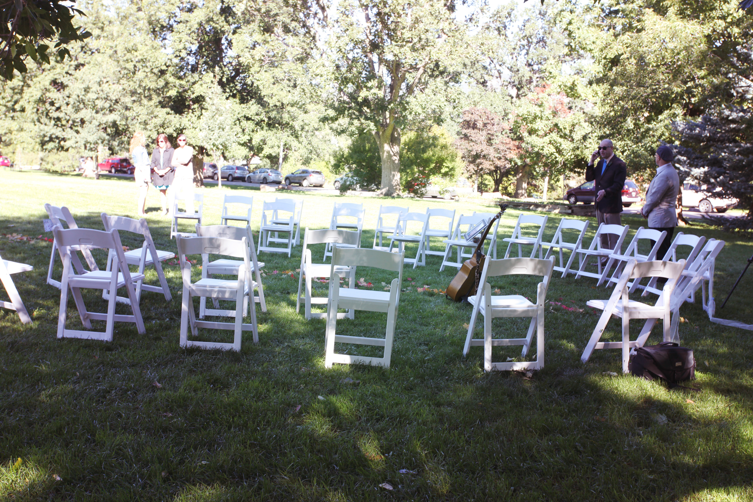 Intimate seating circle under a beautiful tree in the park.