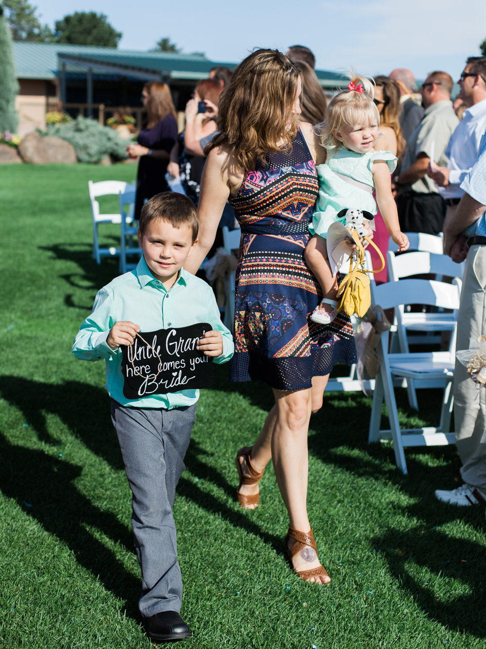 "Next were our flower girl and ring-bearer, or should we say ""sign-bearer"" ;)"