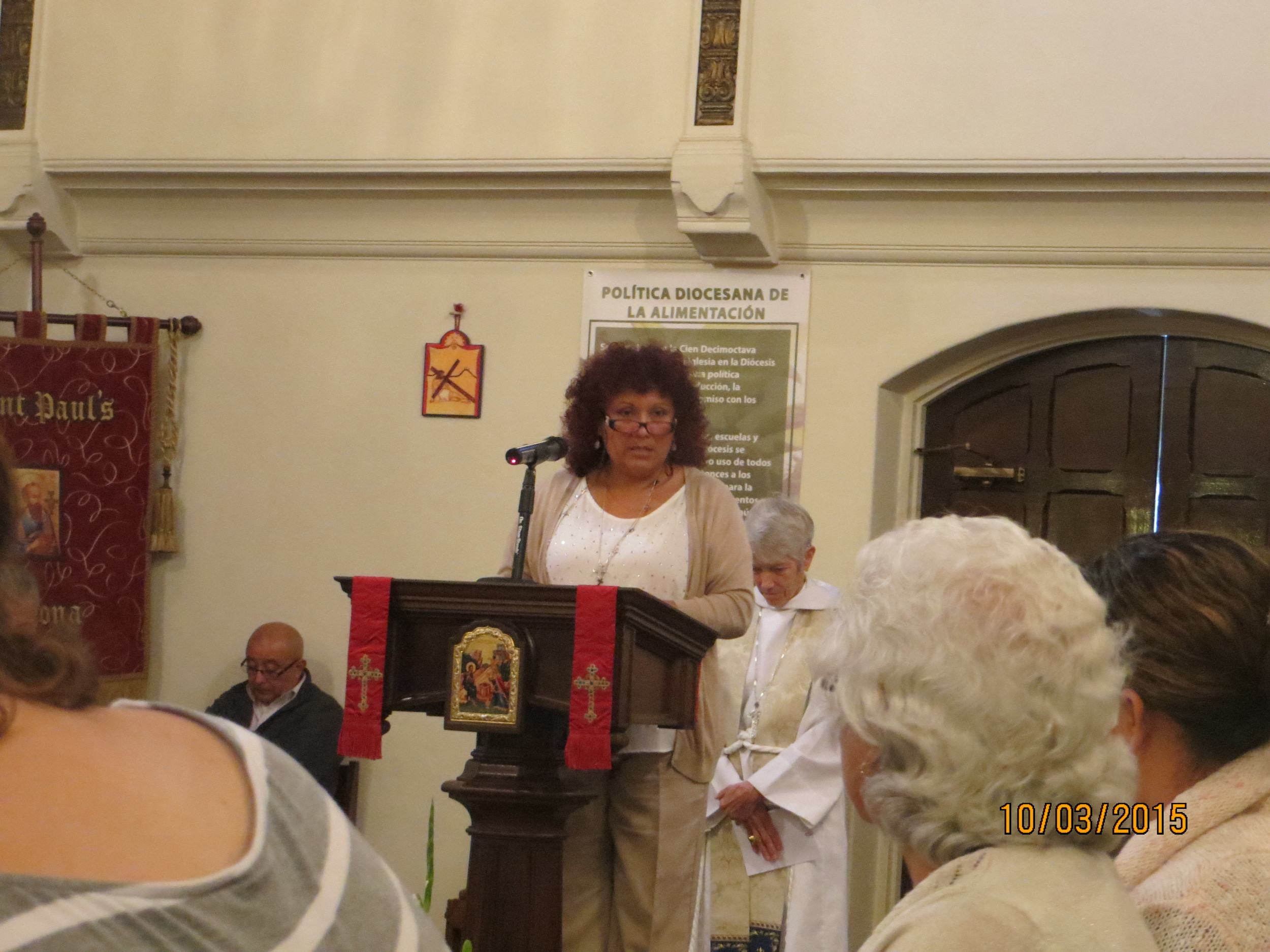 SANDRA TRANSLATING HOMILY.jpg