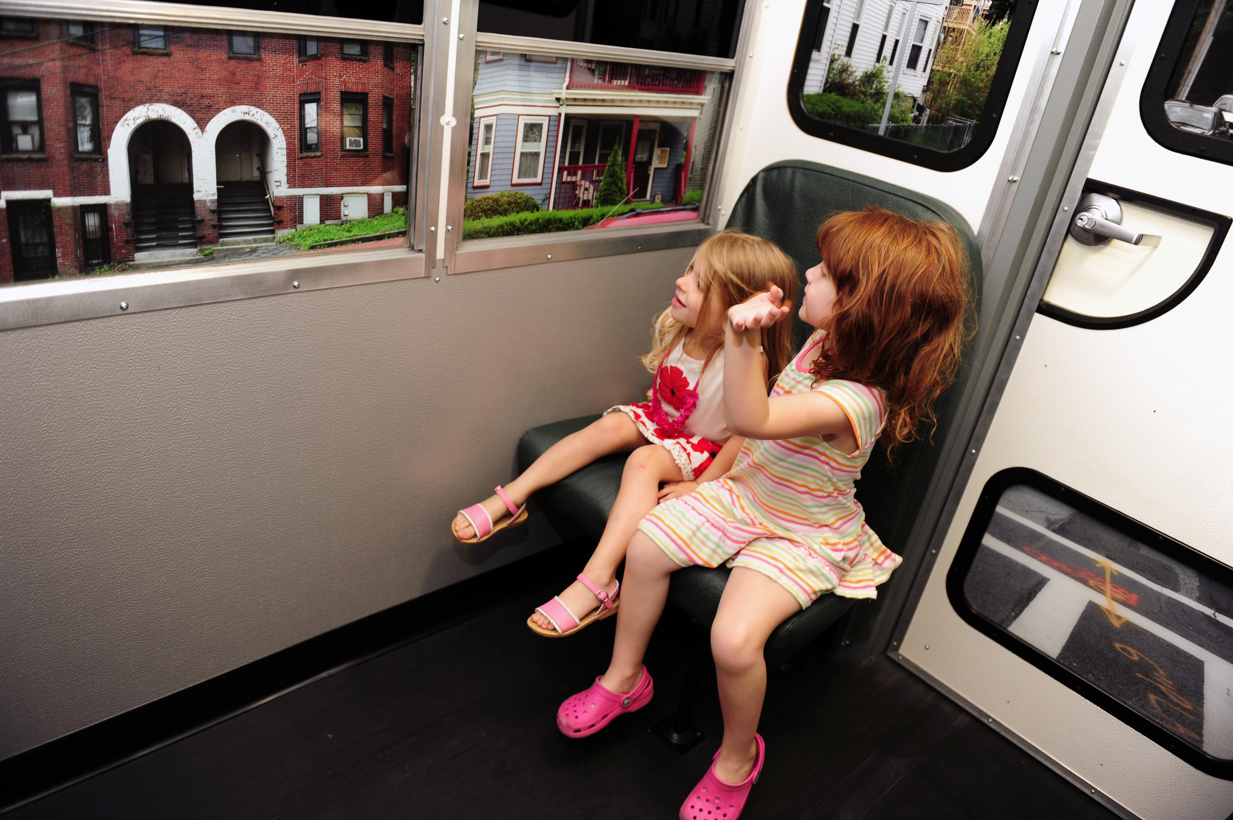 phopro-int-girls in bus-300ppi-14x9.jpg