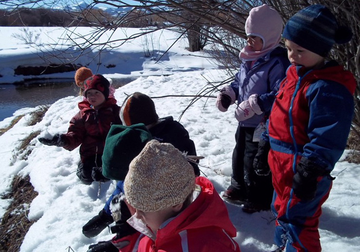 """Students inspecting thermal pools at  """"The Ranch"""" Teton County Children's Learning Center"""