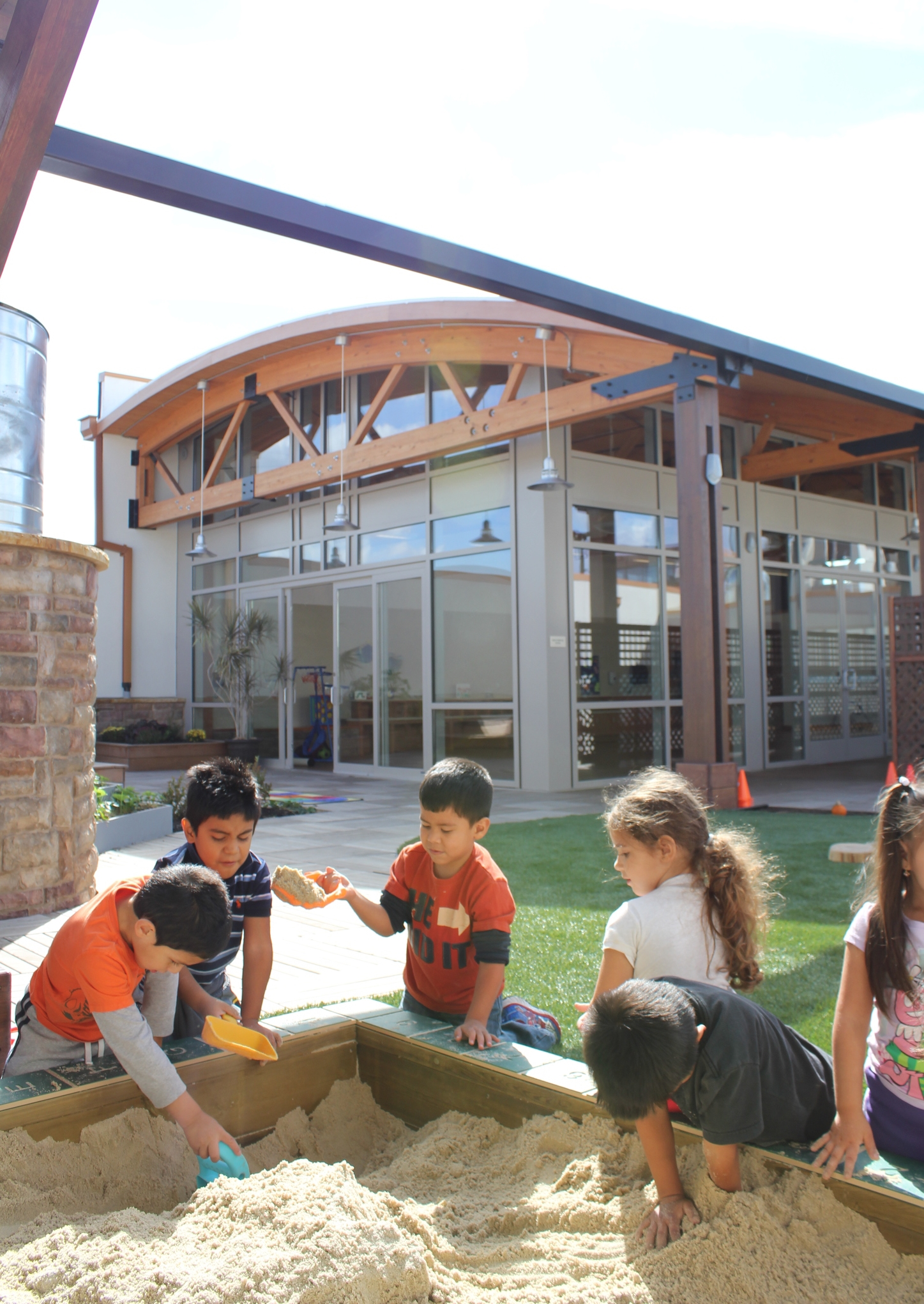 Preschoolers enjoying the sandbox on the rooftop playground, Photo by Sean Gray