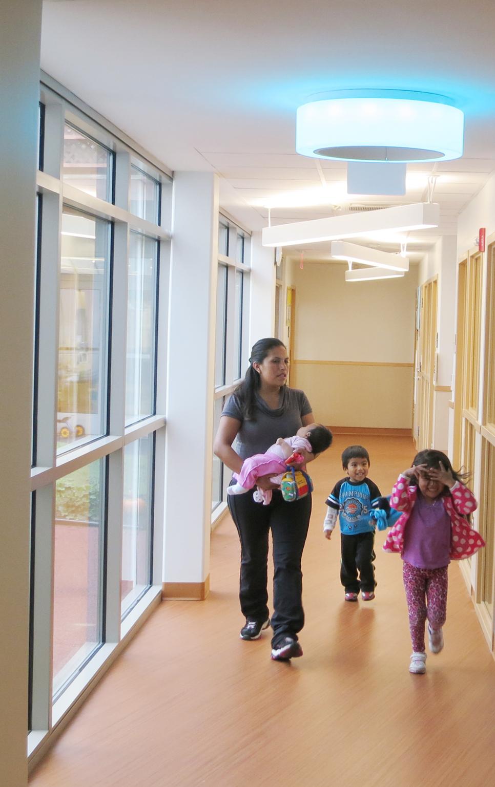 pho-int-lobby hallway w teacher infant-adj vert -300ppi-3x5.jpg
