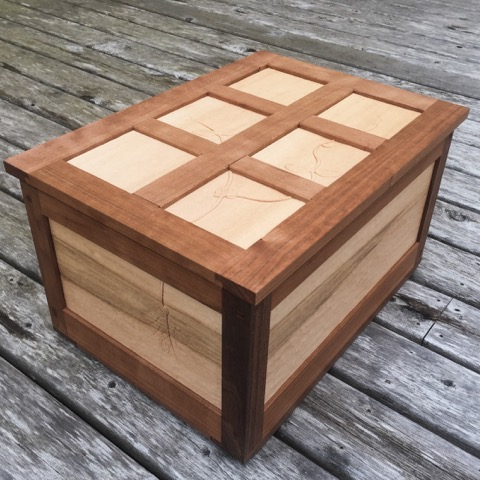 Raphael's final project - a small frame and panel seed chest with carved details.
