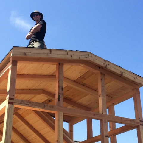 Raphael standing atop his house during the Tiny Home course.