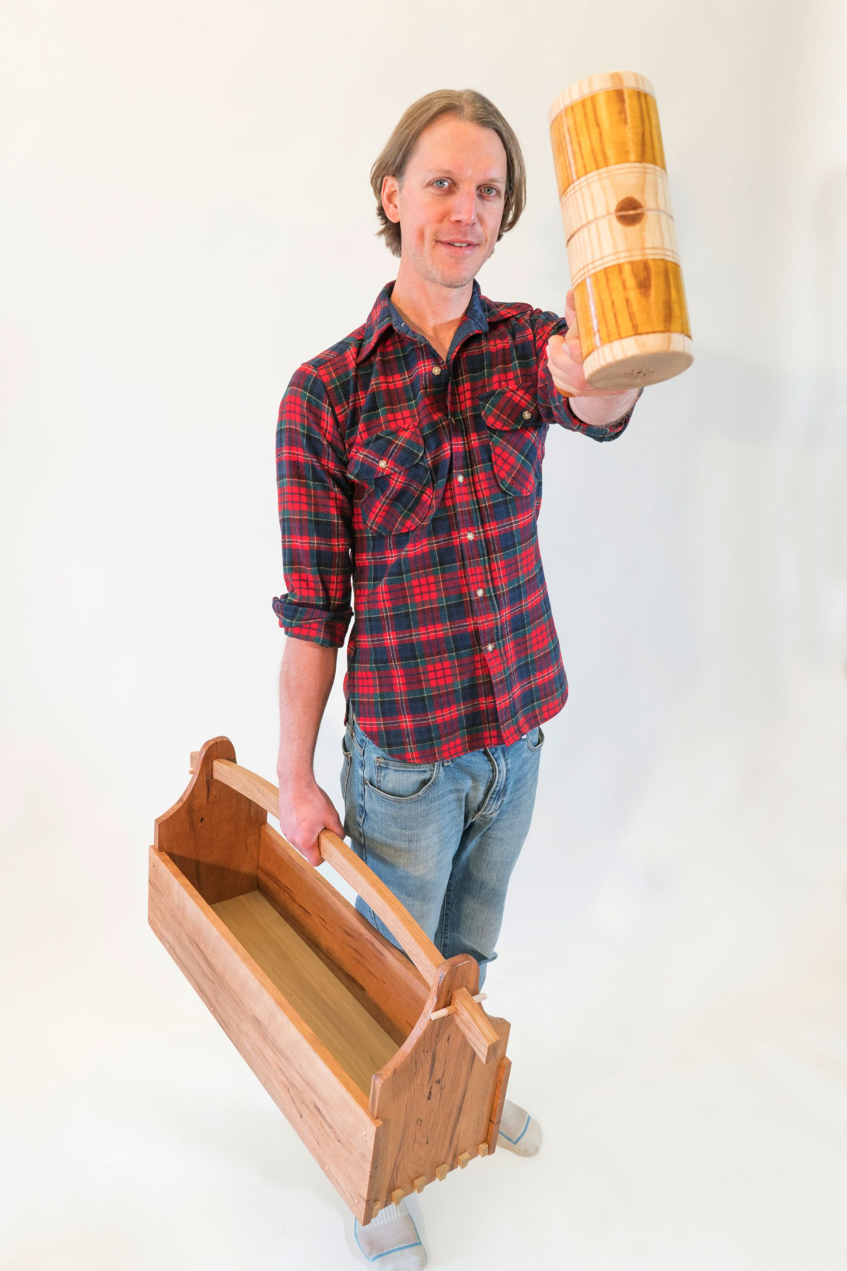 Tool tote in one hand and turned mallet in the other, Corey White