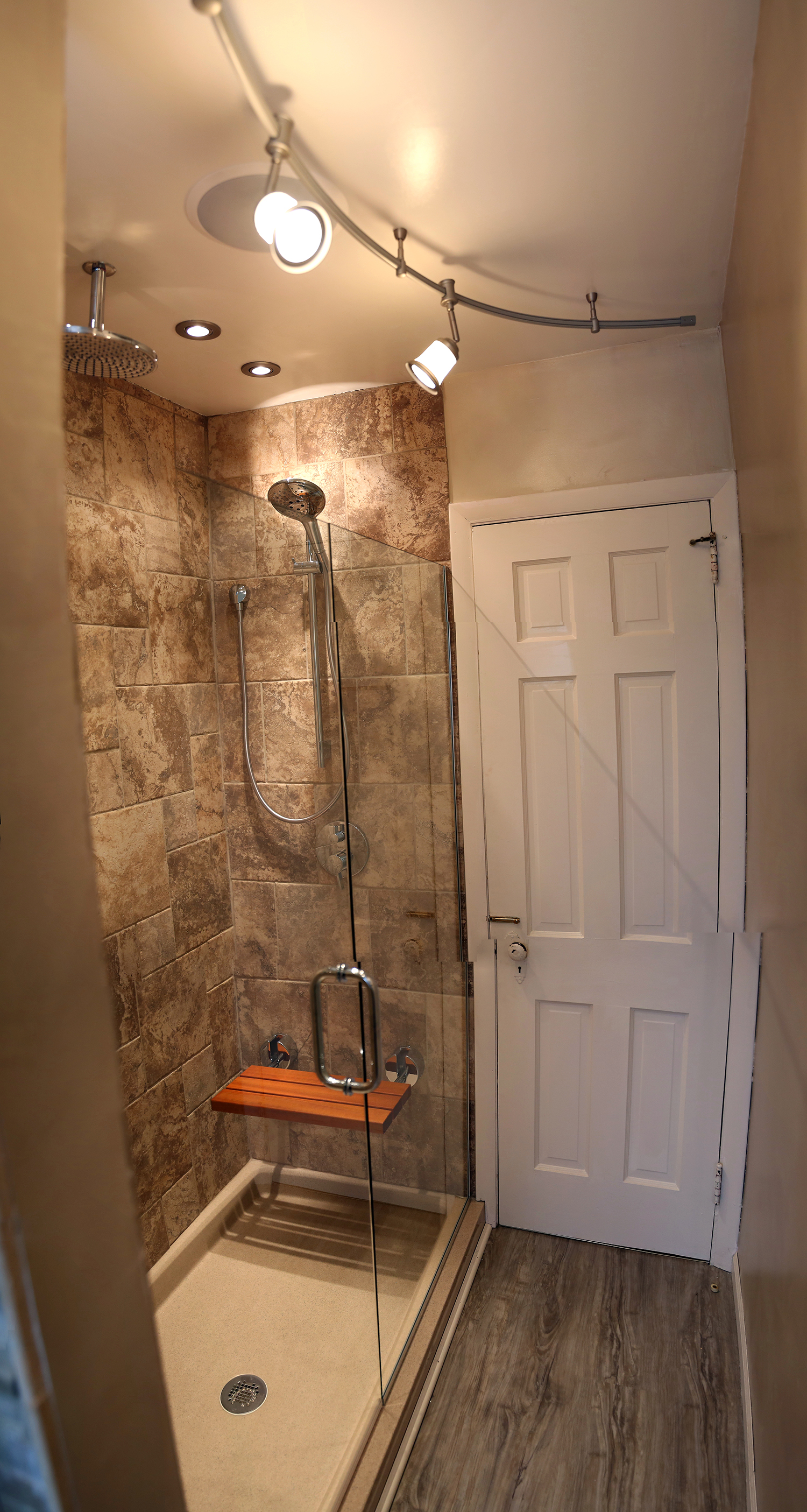 The fold down seat was also from Hudson Reed which is great to fold up when not in use.  We used Hansgrohe Shower heads, and Michael had to have the rain head.