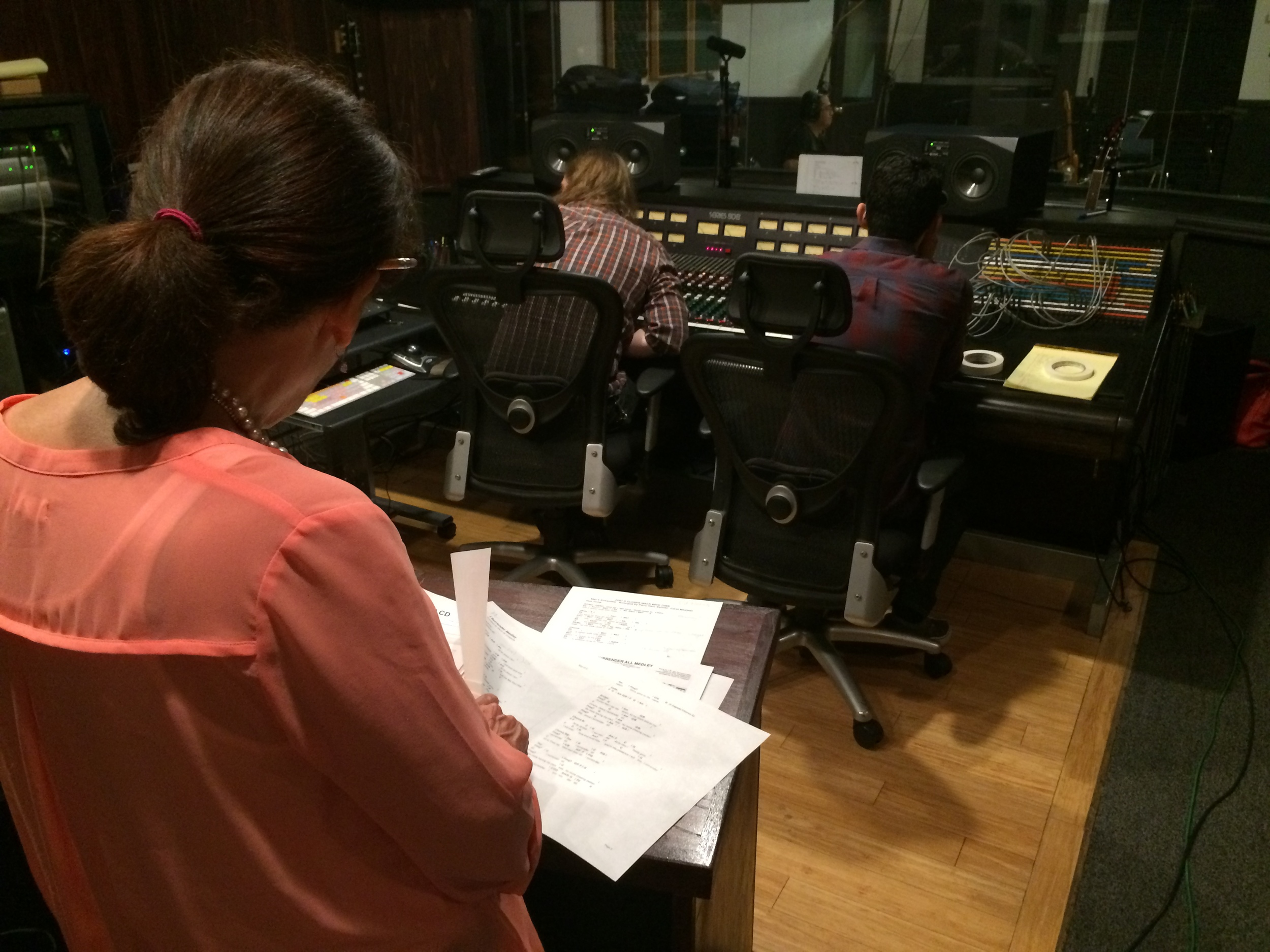 Katheryne Levin directing the session in control room .