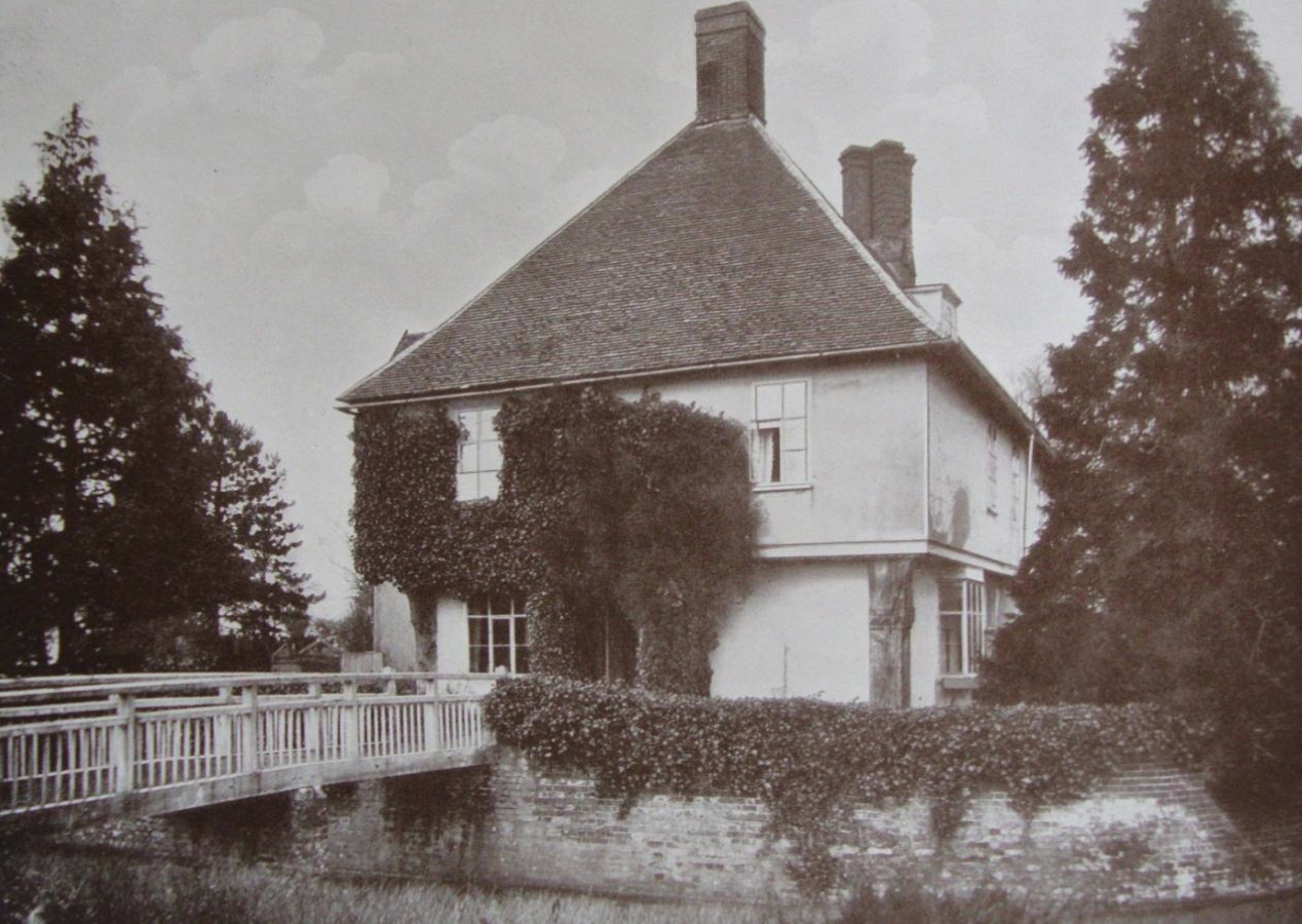 Fig.1 Letheringham Lodge (1919 sales catalogue, SROI, f SC142/1)     2.3  Following his visit to the property in September 1915, an article about Letheringham Lodge by the Reverend Edmund Farrer (1848-1935)   appeared in the 'East Anglian Miscellany' in 1919.     2.4  Farrer wrote that there was belonging to the Wingfield family a lodge, situated on high ground not far distant from their seat at The Hall,    and he suggested that this building was probably allotted for a residence to any widow of the main line, though possibly at other times to one of the younger sons.     2.5 Farrer observed that the Lodge was almost square, with an overhanging upper storey, and that at each corner there was a huge oak post. He also recounted that there was a fine staircase, which he ascribed to the earlier years of the seventeenth century, which ascended to an are  a where there were 'walls covered with wainscot of as fine and as early a pattern as any in the county'. On the lower   floor, in the kitchen, Farrer noted the doorway which has the inscription   'EW 1610'.