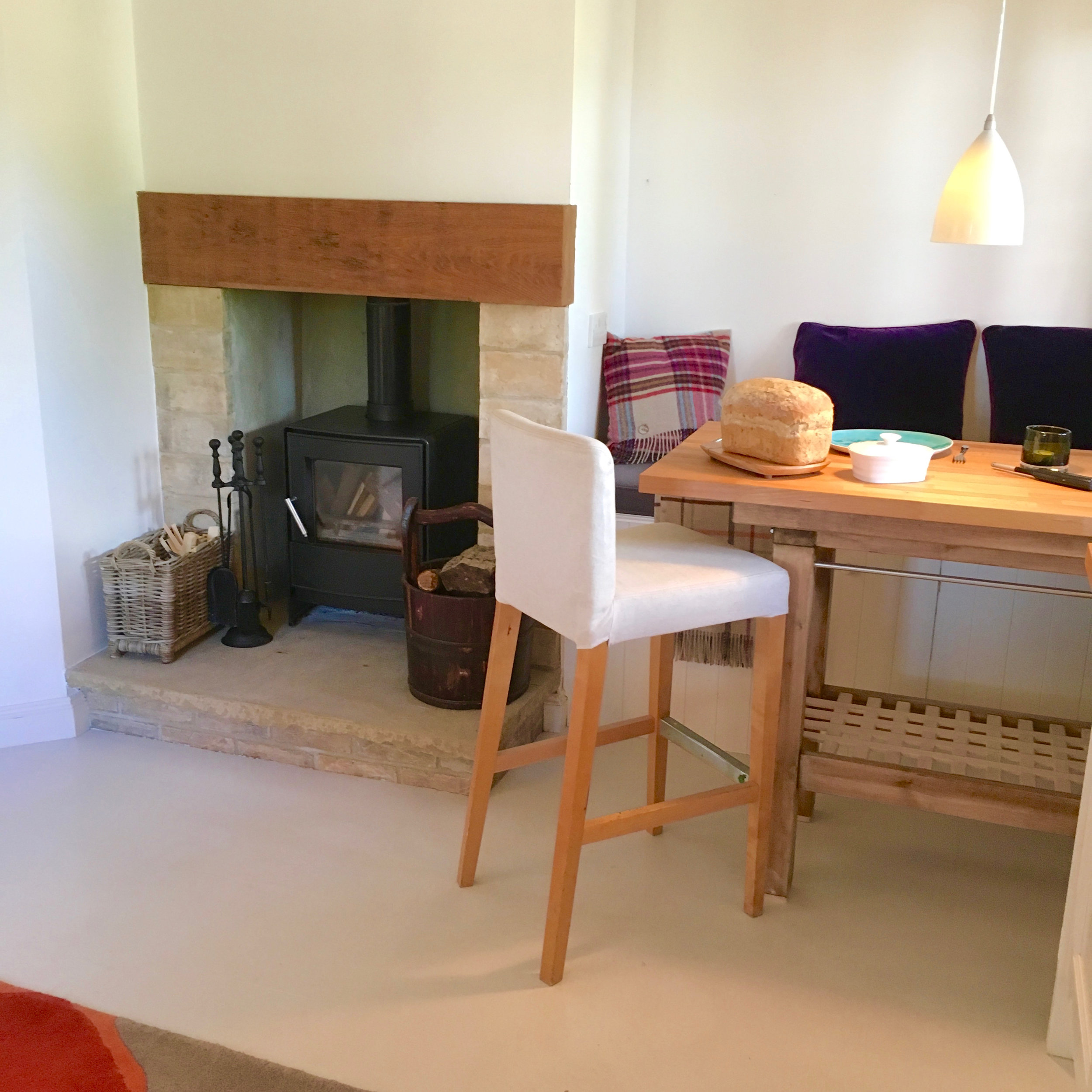 Lounge with dining area and woodburner with infinite firewood