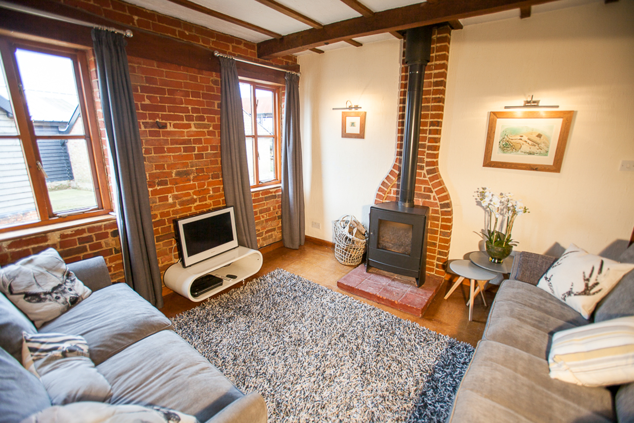 Lounge with two 3 seater couches and wood burner TV with broadband internet