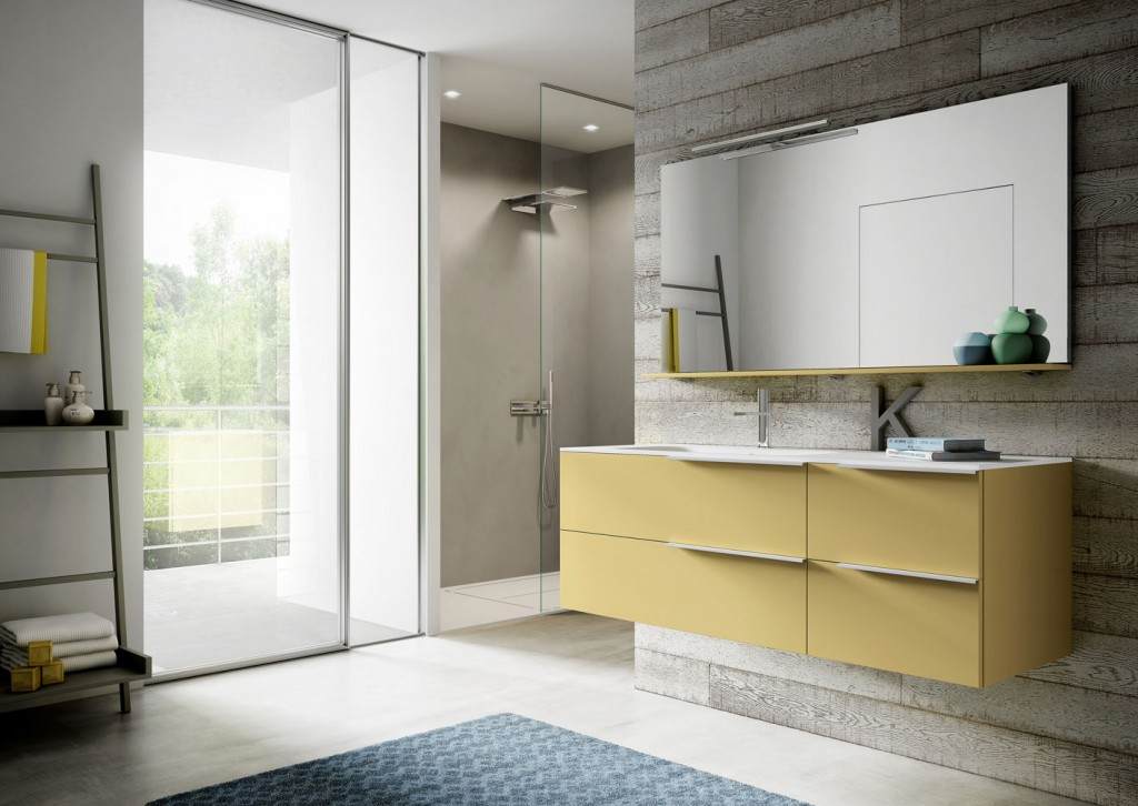 wall mounted bathroom vanity in yellow with hanging mirror above it