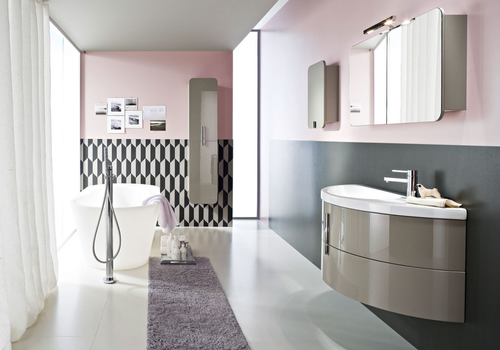 crescent-shaped floating bathroom vanity with rounded bath tub
