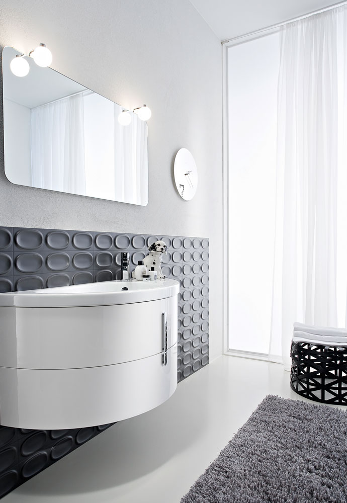 curved floating bathroom vanity in white with small hanging mirror