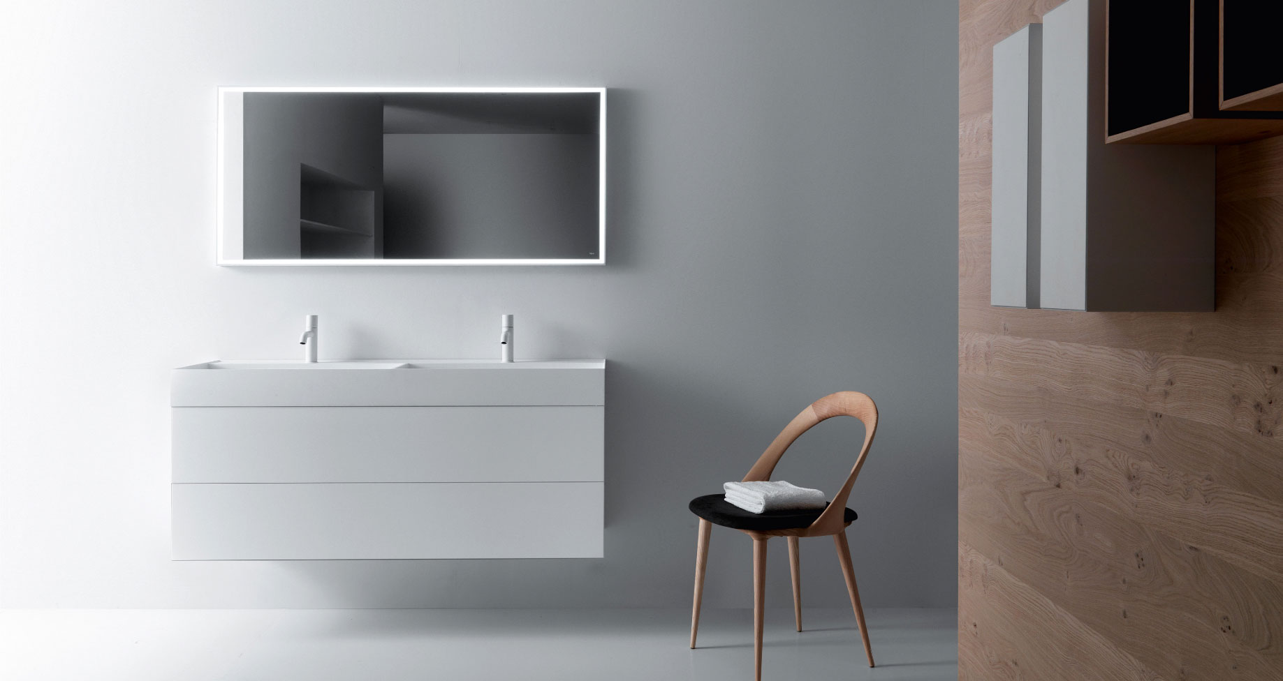 Minimalist modern bathroom vanity with wooden wall and chair