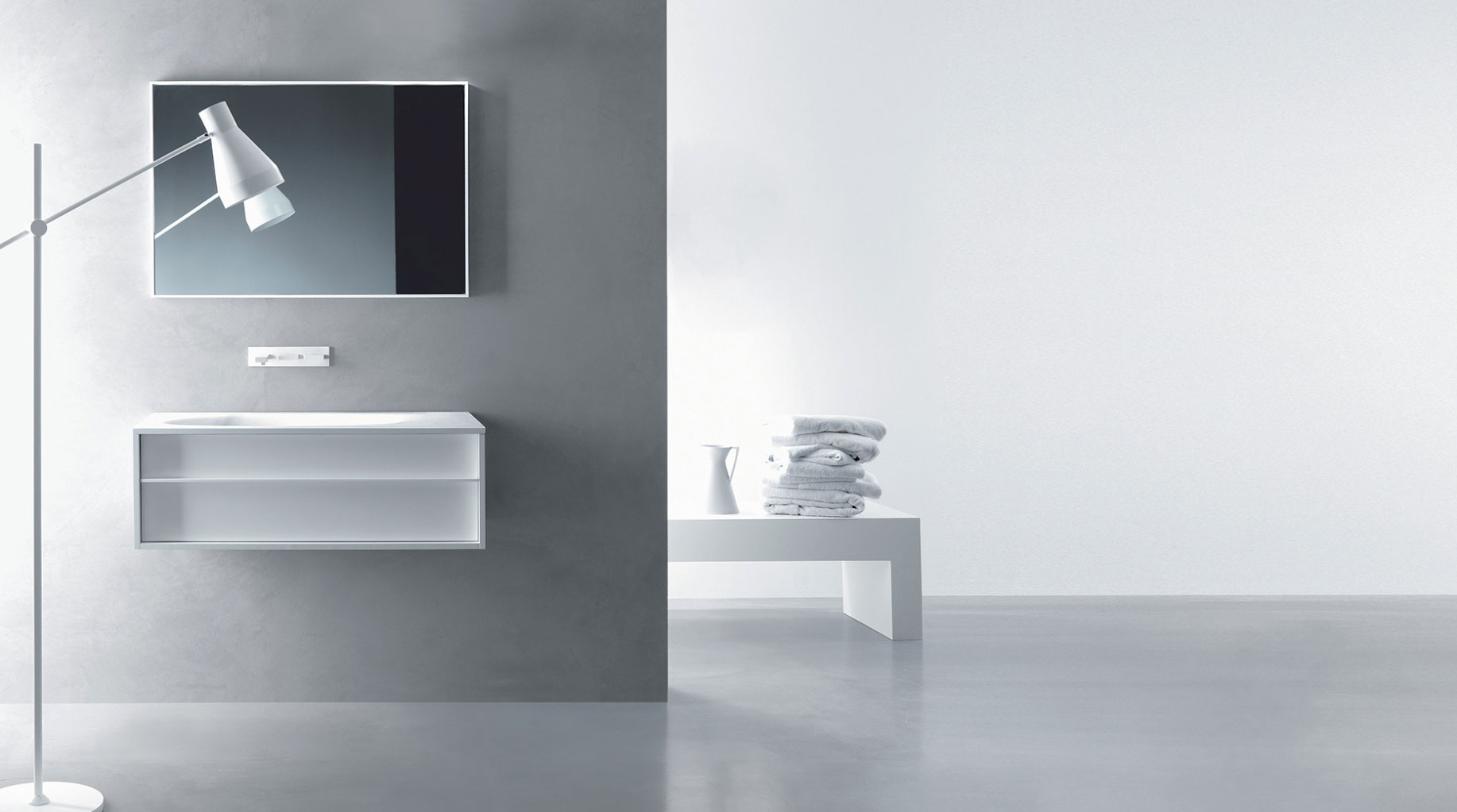 small modern wall-mounted bathroom vanity with integrated sink and wall-mounted faucet