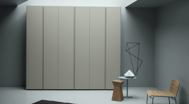 Tall minimalist wardrobe with plain doors