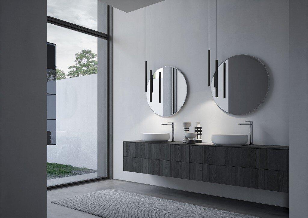 modern bathroom with floating bathroom vanity, circular wash basins and circular mirrors