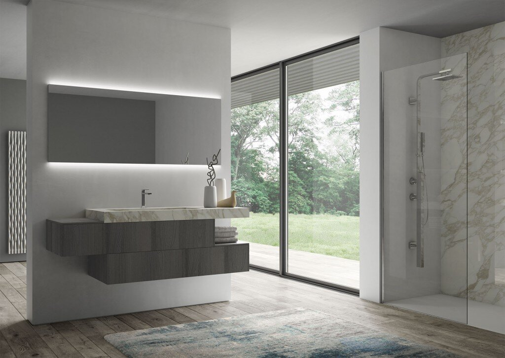 unique modern bathroom vanity in two offset sections with large backlit mirror