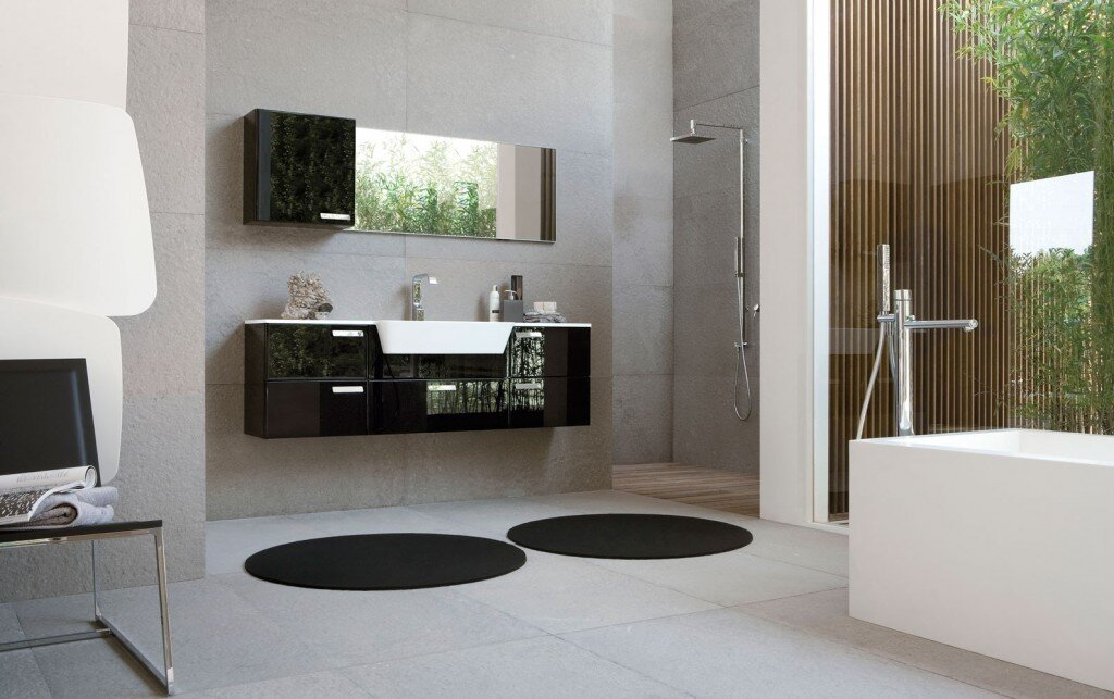 floating bathroom vanity in dark color with circular rugs and angular bath tub