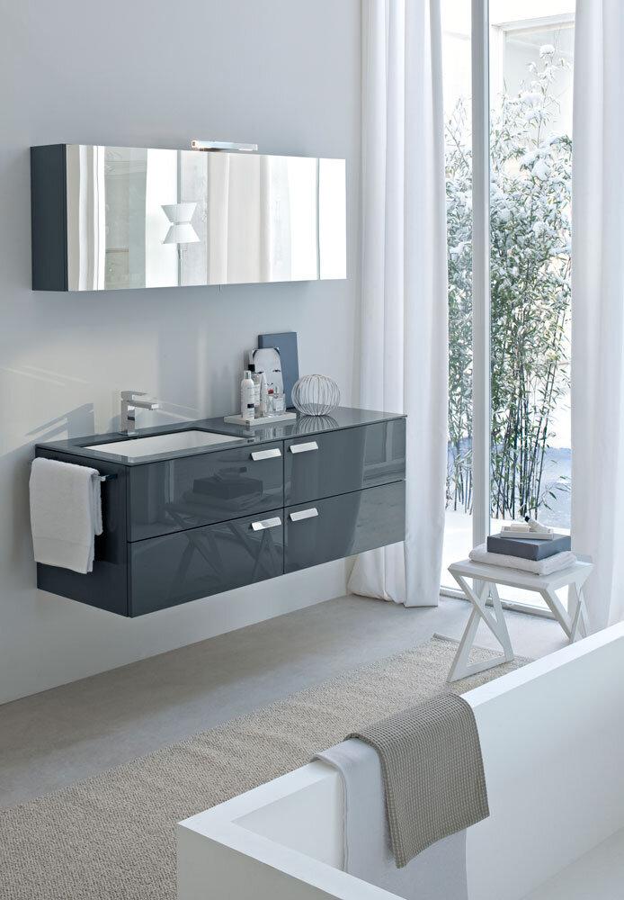 floating bathroom vanity with integrated sink, and angular bath tub