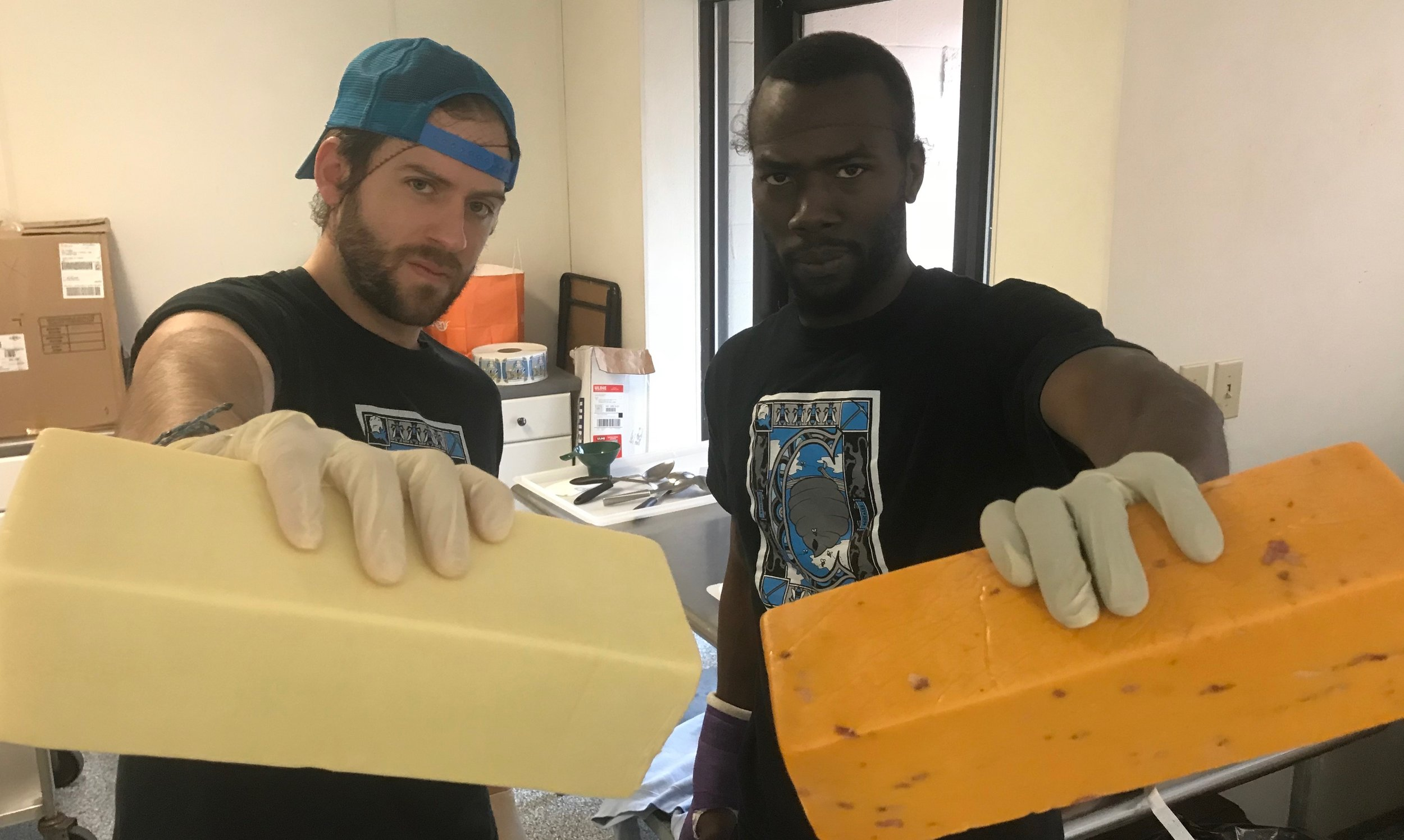 Marcus and I attempting our toughest cheese-snarls.