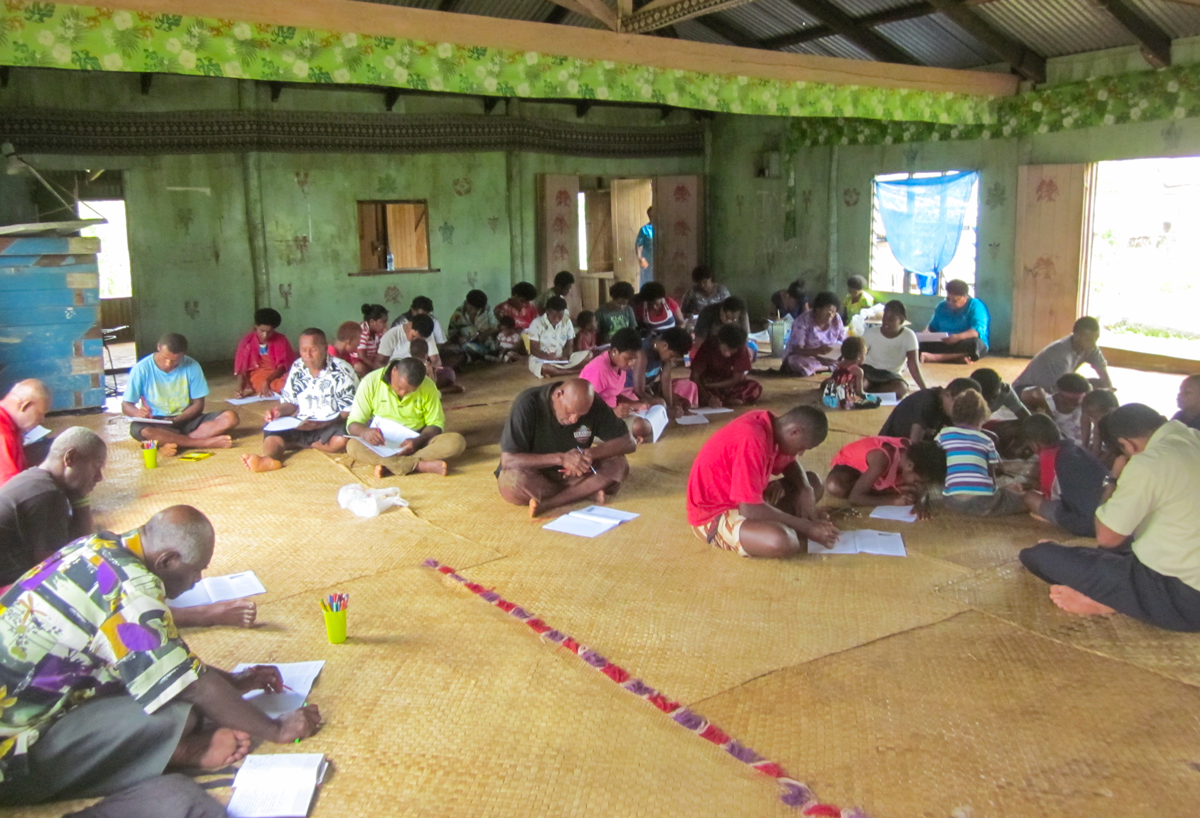 The men, women and children of Naseibitu Village working on their drawings.