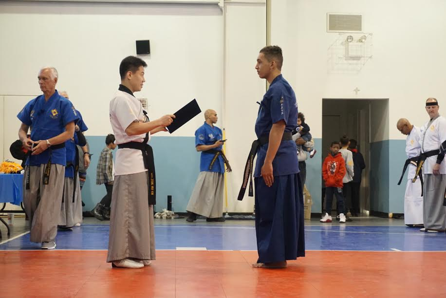 Anthony receiving his Black Belt in Haidong Gumdo (sword).