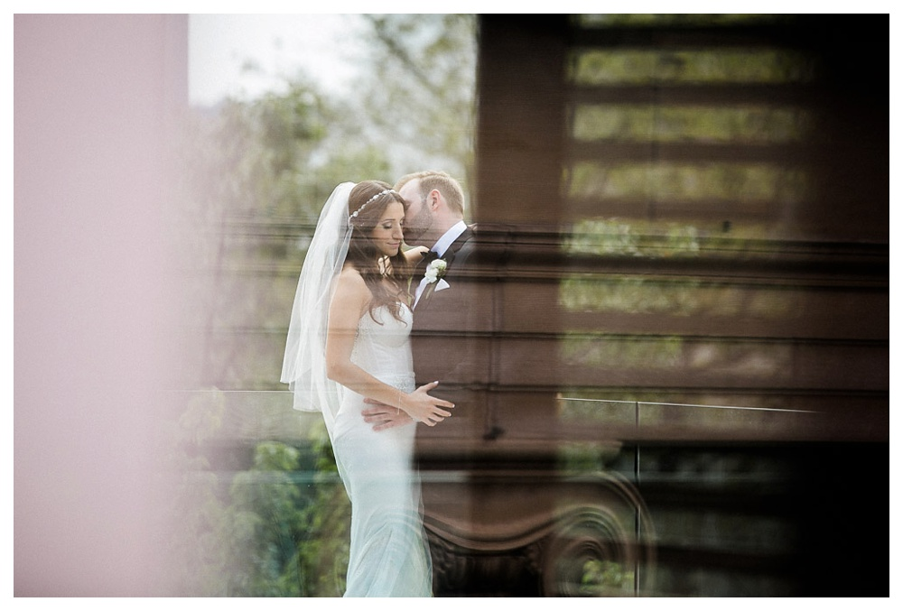 White Toronto, luxe, wedding, wedding dress, Gardiner Museum, 99 Sudbury, Ashley Lindzon, reflection, kiss, love, bride and groom, Inbal Dror,