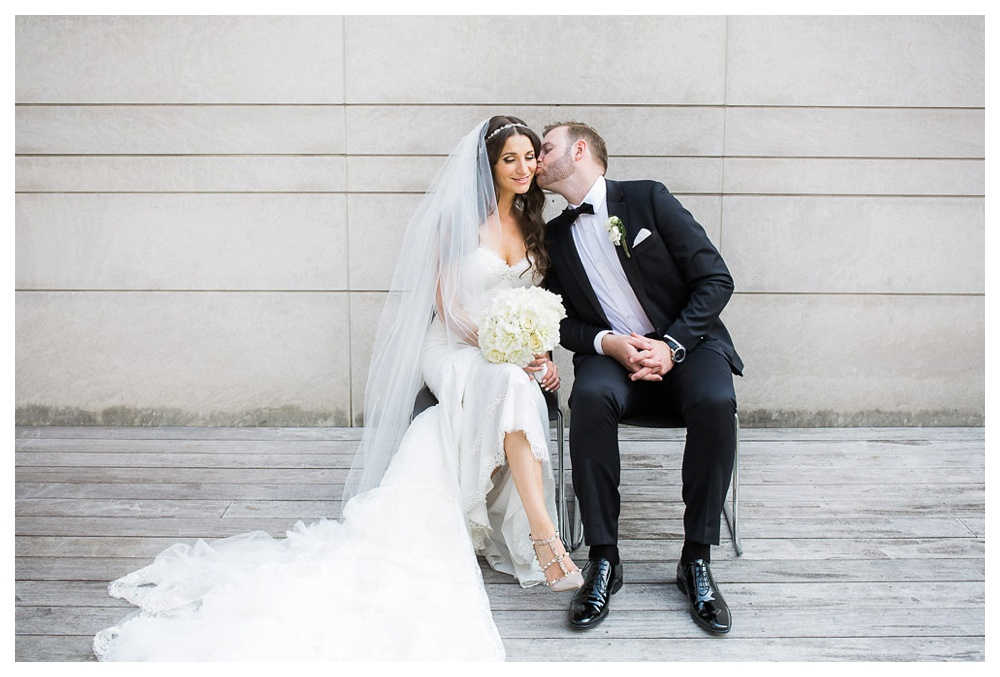White Toronto, luxe, wedding, wedding dress, Gardiner Museum, 99 Sudbury, Ashley Lindzon, modern, Danijela Weddings, Inbal Dror, Mendocino, Indochino, Hugo Boss, bride and groom, kiss, flowers,