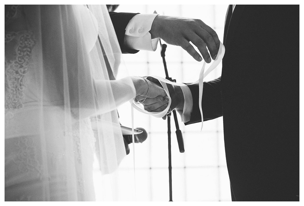 White Toronto, luxe, wedding, wedding dress, Gardiner Museum, 99 Sudbury, Ashley Lindzon, ceremony, vows, hand tying, black and white, wedding ceremony, love, wedding day