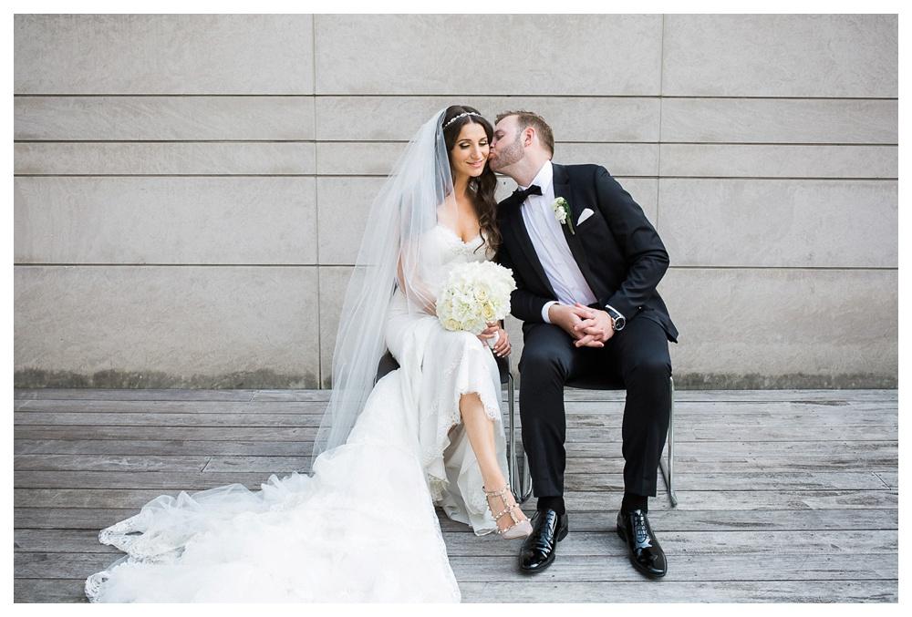 48-DanijelaWeddings-wedding-Toronto-AshleyLindzon-Inbaldror-therom-gardinermuseum-99sudbury-kiss.JPG