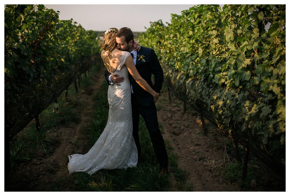 55-DanijelaWeddings-wedding-RavineWinery-NiagaraOnTheLake-vineyard-vines-love-sunset-kiss-AlexandraMcNamara-BlushandBowties.JPG