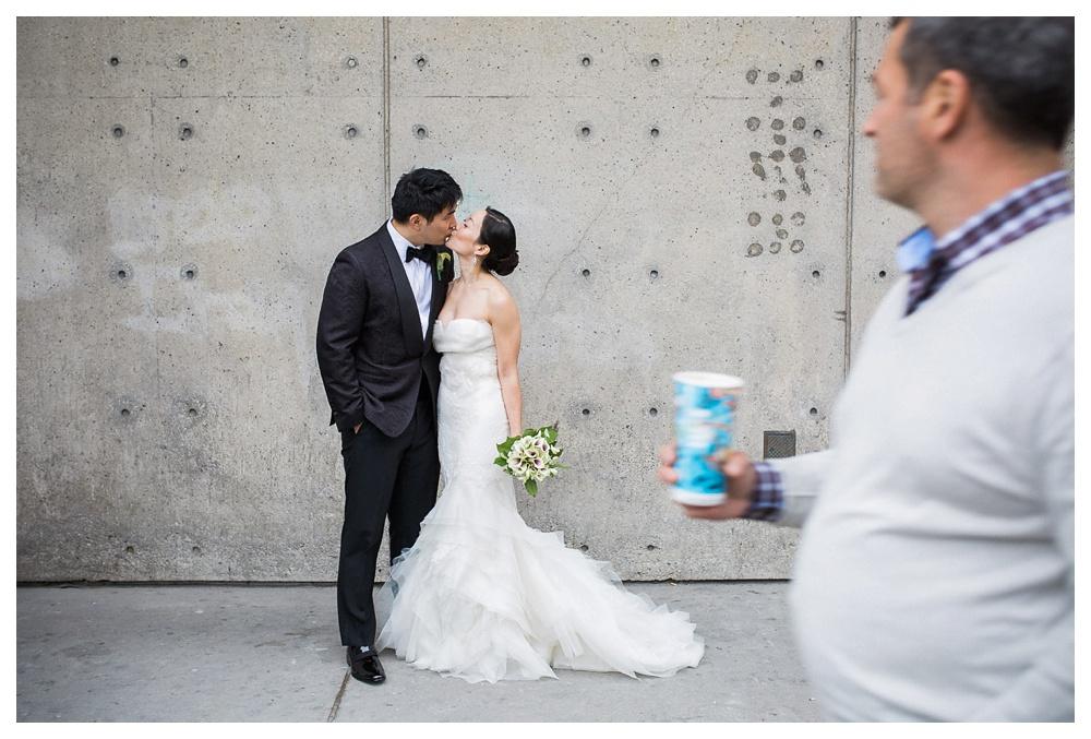 66-DanijelaWeddings-Toronto-wedding-Arcadian-VeraWang-couple-kiss-passby.JPG