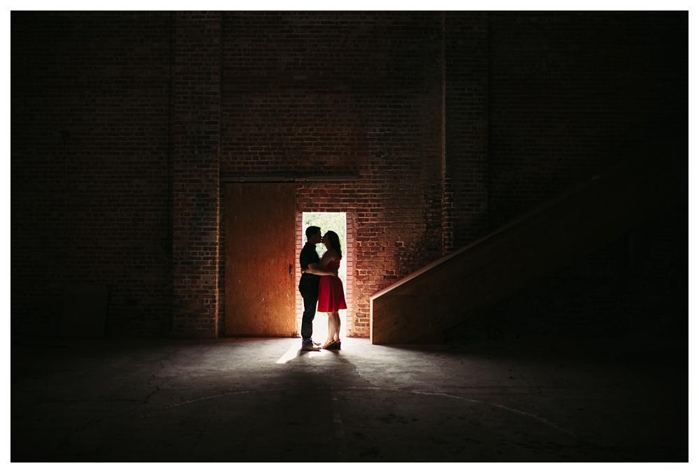82-DanijelaWeddings-engagement-couple-doorway-abandonedbuilding.JPG