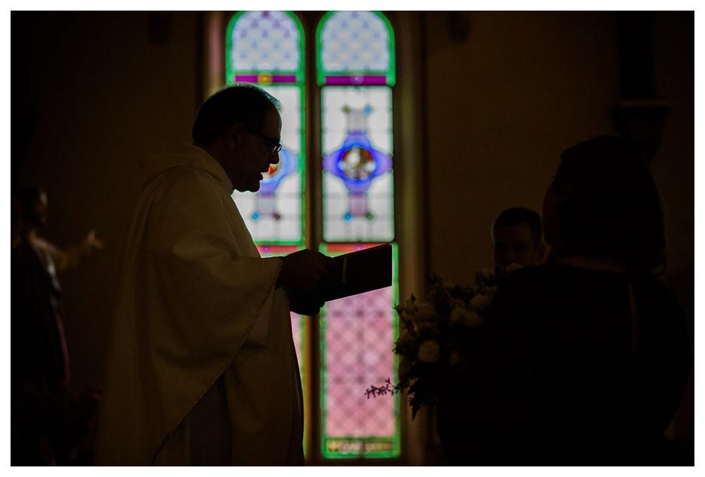 85-DanijelaWeddings-wedding-BlueMountain-skichalet-church-stainedglasswindow-priest.JPG