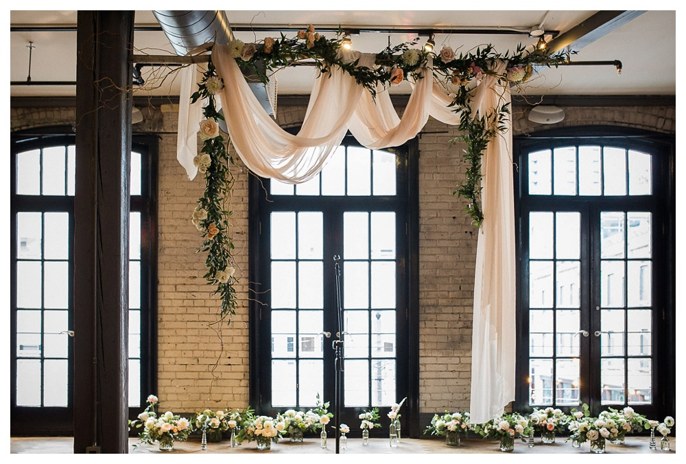 92-DanijelaWeddings-wedding-Toronto-BlueJays-StorysBuilding-BlushandBloom-ceremonybackdrop-flowers.JPG