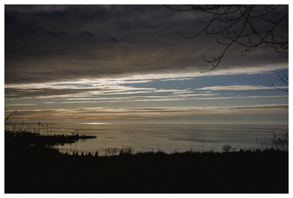 Sun rising over lake Ontario at Scarborough Bluffs Park.