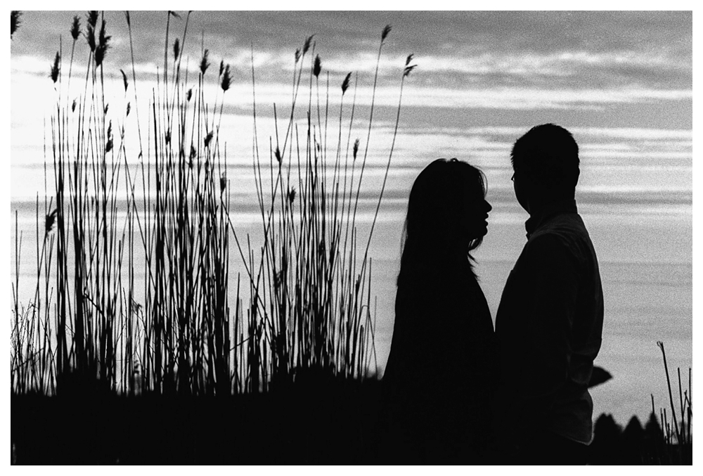 Black and white nature engagement photos by scenic lake Ontario
