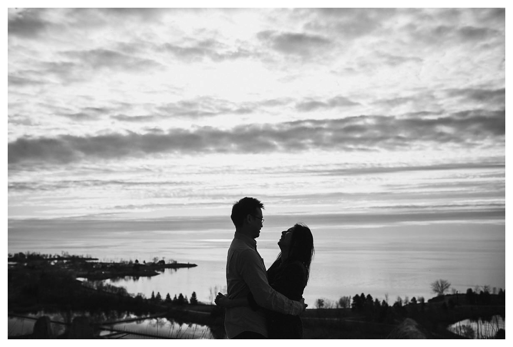 With the view of lake Ontario from the perfect spot in Scarborough Bluffs, laughter and joy comes to life in engagement photos.