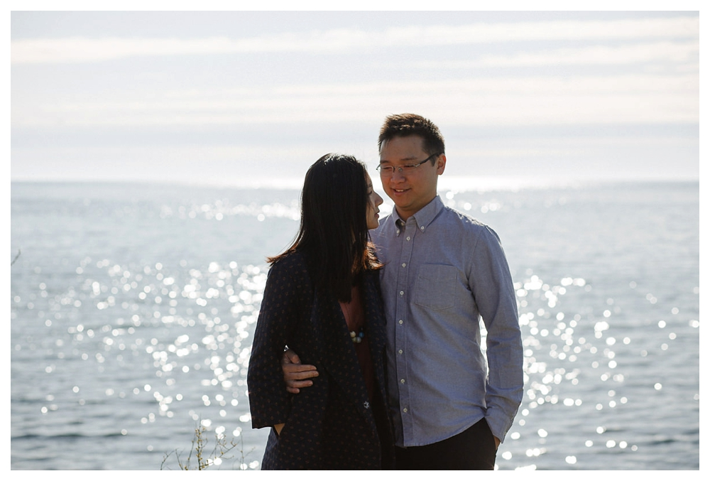 The twinkle of the sun on lake Ontario mirrors the twinkle of the love in the groom's eyes.
